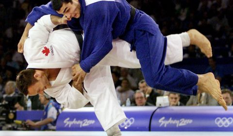 Canada's Keith Morgan (left) of Calgary, Alta. throws Azerbijan's Rasul Salimov to win the match in 90 kg judo competition at the Olympics in Sydney, Australia Wednesday Sept. 20, 2000. (CP PHOTO/Kevin Frayer)